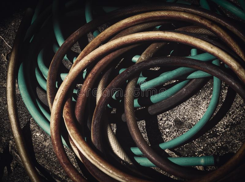 Old garden water hose royalty free stock image