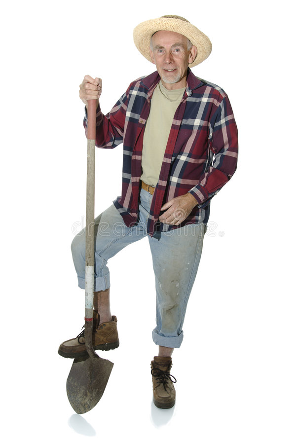 Old gardener with foot on spade stock photos