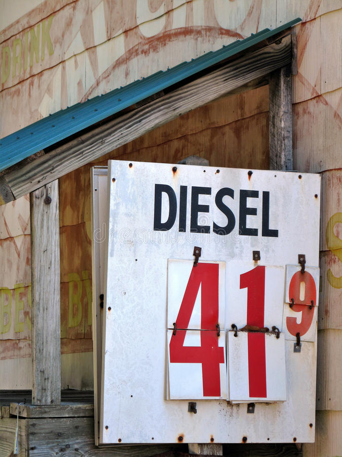 Old Gas Price Sign. An old abandoned roadside general store diesel price sign royalty free stock photography
