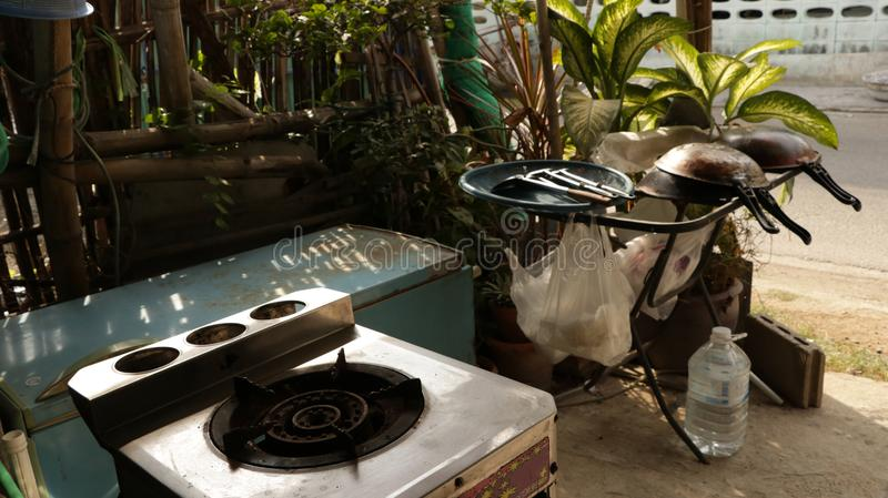 Old Gas Stove with Vintage Kitchen Utensils in the Garden stock image