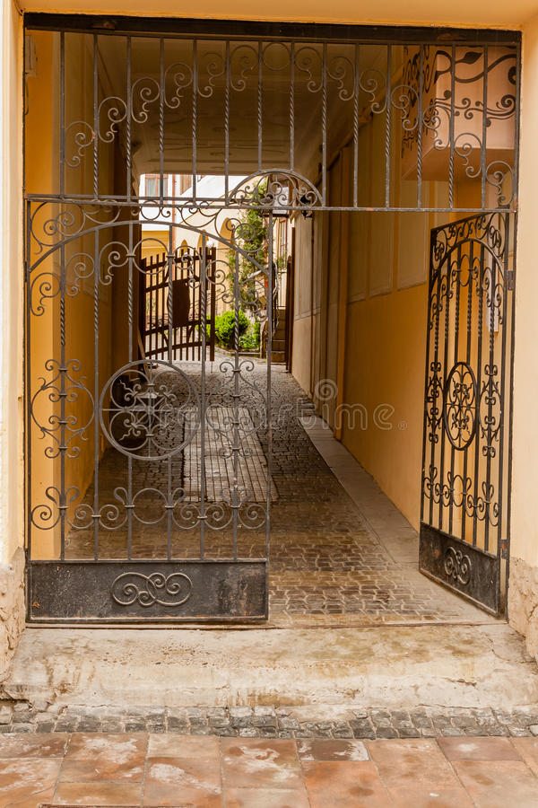 An old gate with a corridor leading to the courtyard of the house royalty free stock photos