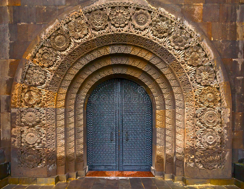 The old gate. Steel doors. Carving in stone stock photo