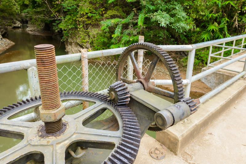 Weir or Dam at Wang Sila Laeng, Thailand. Old gear and rusted cogwheel mechanism, cog gear wheel for watergate, Weir or Dam at Wang Sila Laeng, Thailand royalty free stock photo