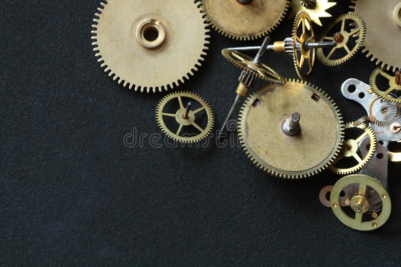 Old Gears. Old assorted gearwheels isolated on dark background with copy space stock photography