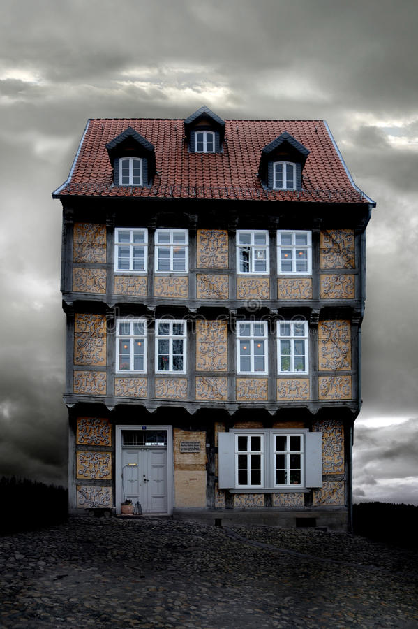 An old German house on dark Autumn evening royalty free stock photo