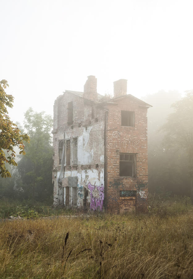 Old ghost house in a fog stock image