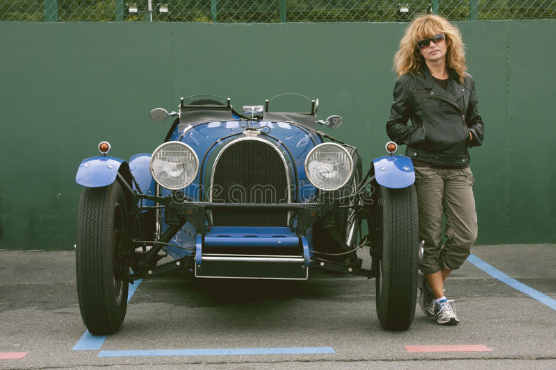 Old girl and car. Girl with urban style and classic sports car royalty free stock photos