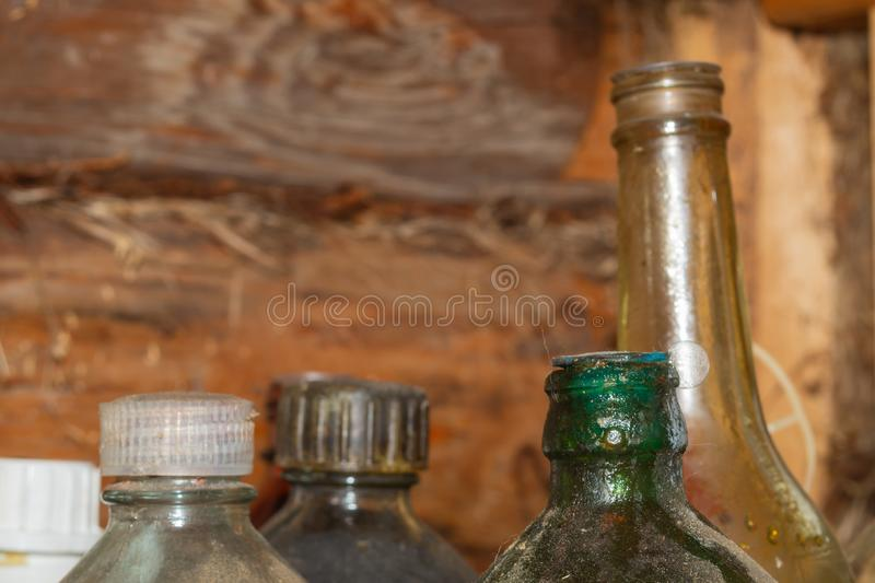 Old glass bottles with technical fluids in workshop. Old glass bottles with technical fluids in a workshop, antique, background, board, chemical, chemist royalty free stock photos