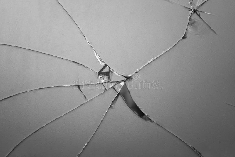 Broken mirror shattered in many pieces. Cracked glass ,The mirror crack Texture Background. Old glass that has been used for long time and has atrace. The mirror royalty free stock image