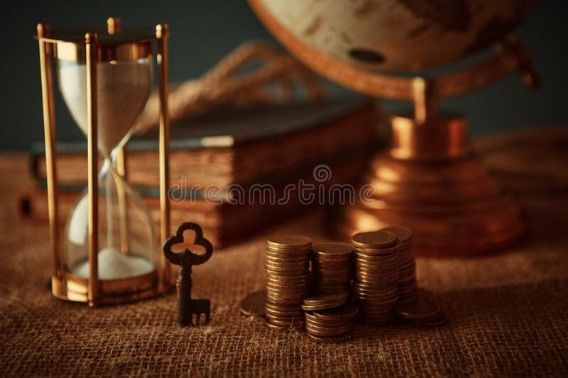 Old globe, coins, magnifying glass, keys to chests, rope, pirate map and marine logbook. Travel and marine prints background. The. Concept of a treasure hunter stock image