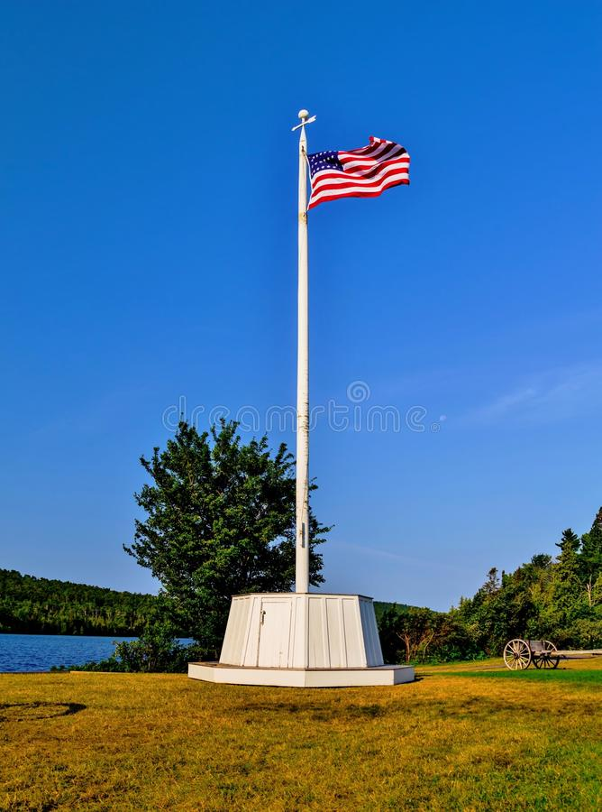 Old Glory. American flag set against a beautiful summer blue sky. Fort Wilkins State Park. Copper Harbor, Michigan stock images