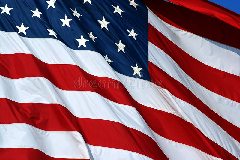 Old Glory. US Flag blowing in the breeze royalty free stock image