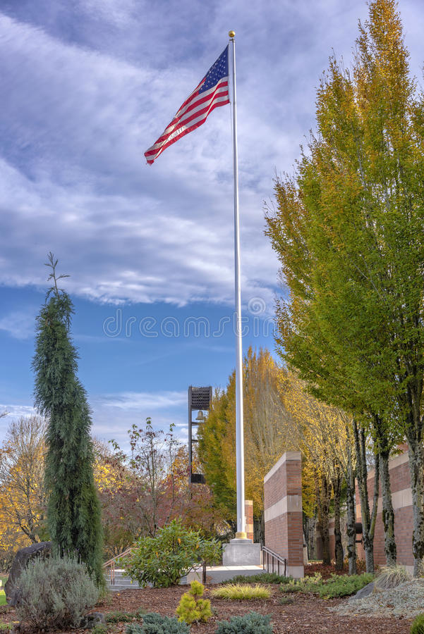 Old Glory waving in the wind Oregon. Old Glory waving in the in the Willamette national cemetery Oregon stock images