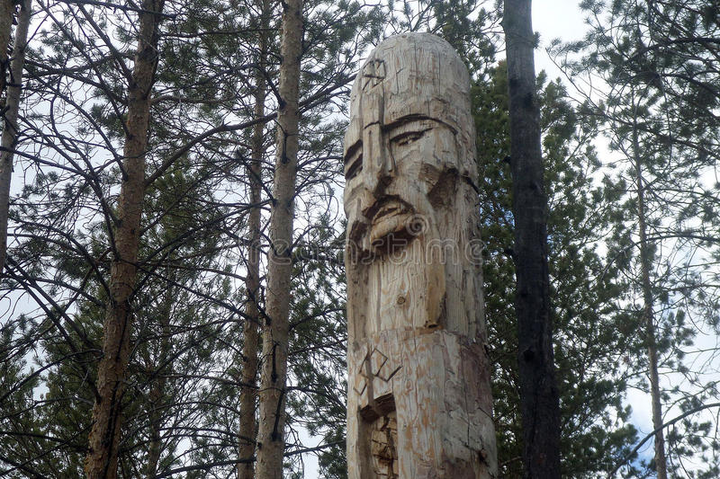 The old gods. The wooden figure of Perun in the forest royalty free stock photography