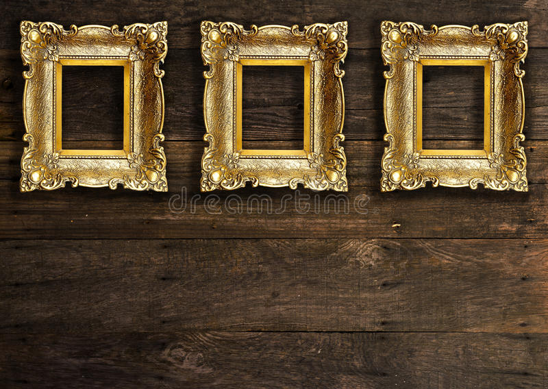 Old Gold Picture Frames On Wooden Wall Stock Photo - Image of design ...