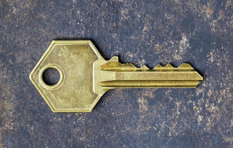 Old gold retro key on metal background royalty free stock photography
