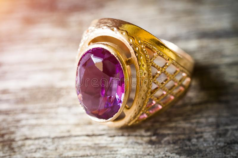 Old gold ring with pink stone stock image