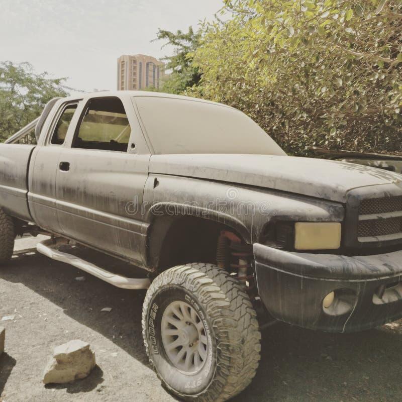 Old but gold rusty heavy pickup dubai stock photography