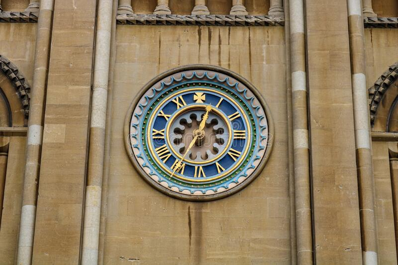 Old gold set clock on front of norwich cathedral east anglia england. United kingdom royalty free stock photos