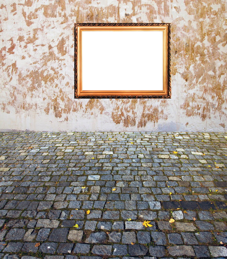 Old golden frame wall and pavement royalty free stock images