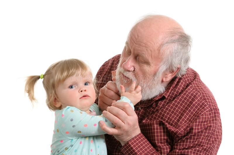 Old good grandpa and his little granddaughter. Little granddaughter exploring the beard of her grandpa, isolated stock photography