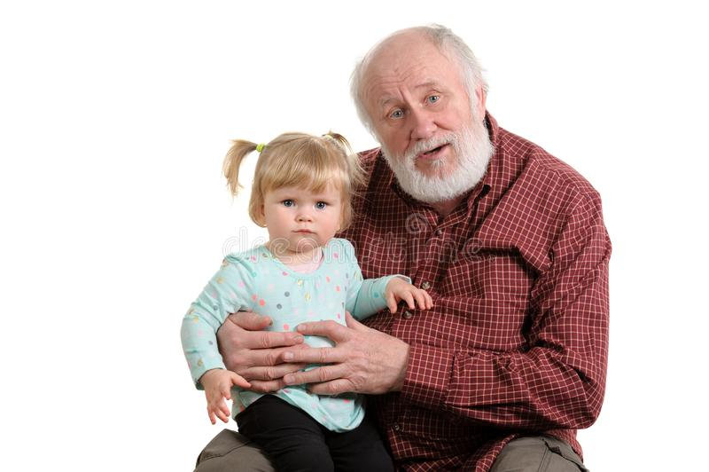 Old good grandpa and his little granddaughter. Little granddaughter sitting at lap of her grandpa, isolated stock photos