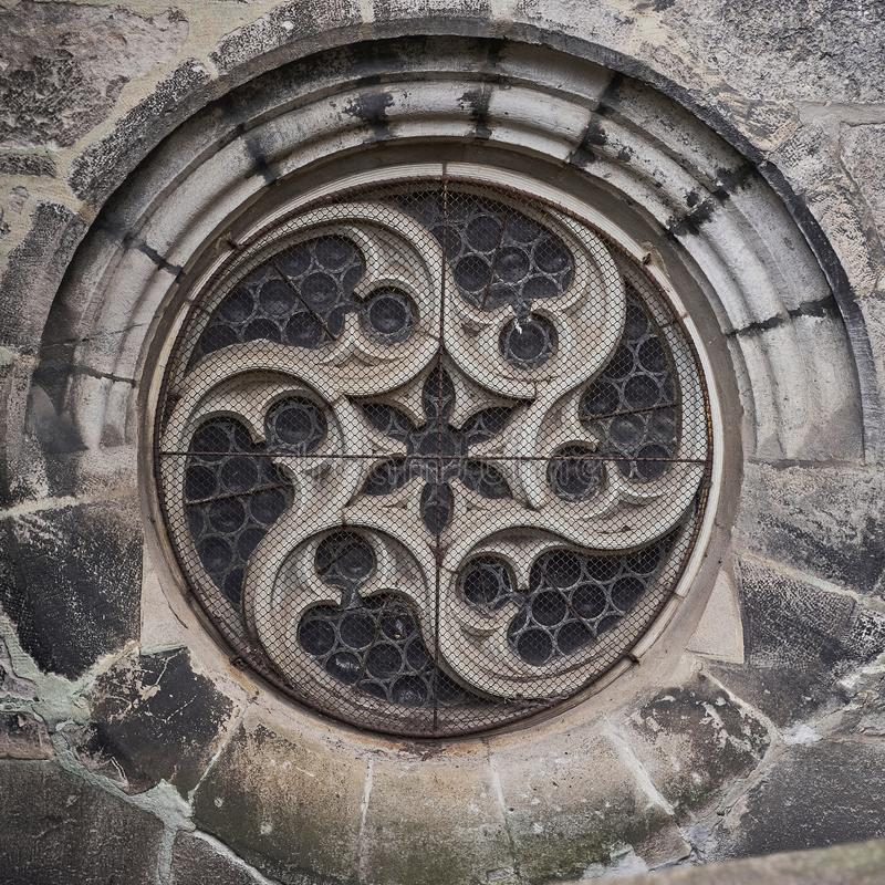 Old gothic cathedral round window. Detail of old gothic cathedral round window in Europe royalty free stock photos