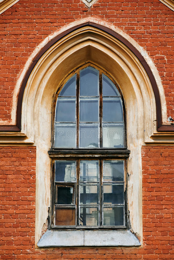 Old gothic window. And old brick brown wall royalty free stock photography