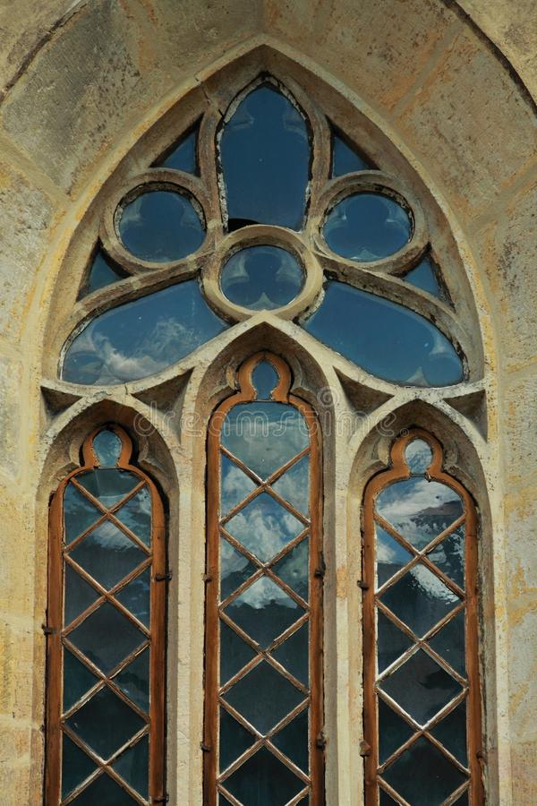 Old gothic window. Of a church stock image