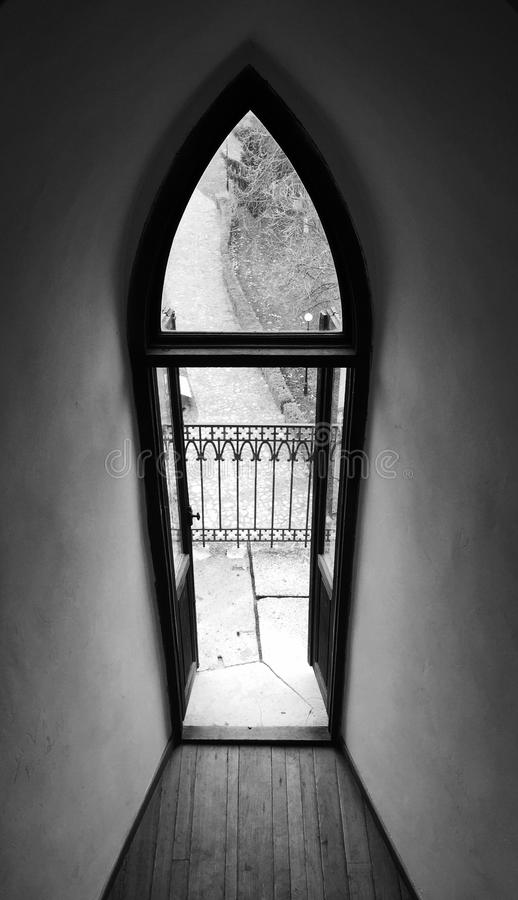 Old gothic window. Tall old gothic window in a castle stock photos