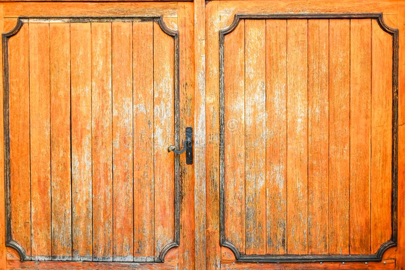 Old gothic wooden doors with lock. Old gothic wooden doors with metal lock. For bacground royalty free stock image