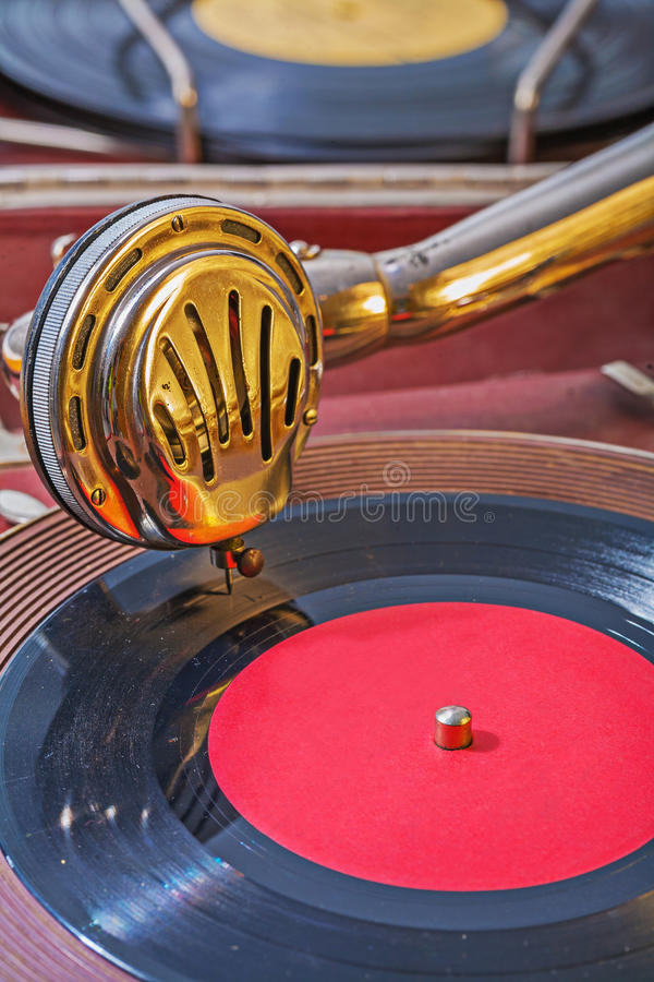 Old gramophone view on speaker on vinil disk royalty free stock photos