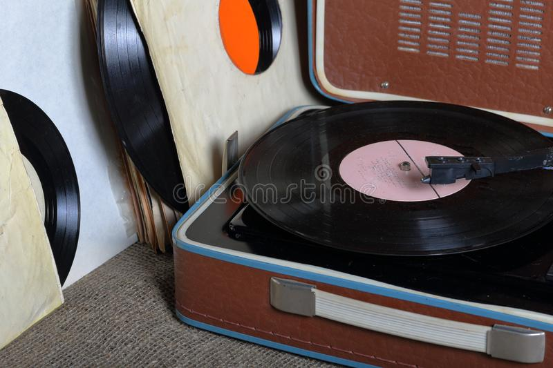 An old gramophone with a vinyl record mounted on it. royalty free stock photo