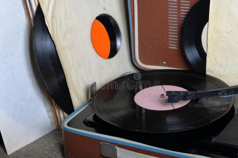An old gramophone with a vinyl record mounted on it. stock photos