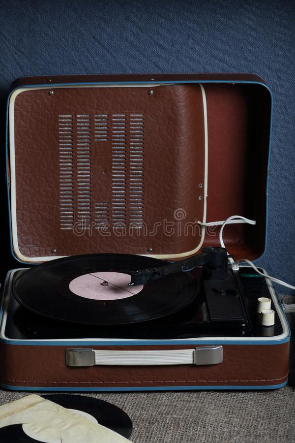An old gramophone with a vinyl record mounted on it. stock photography