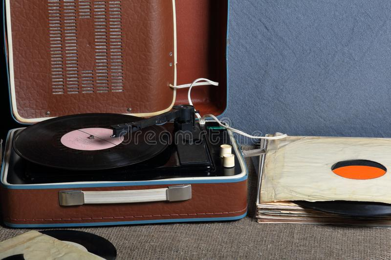 An old gramophone with a vinyl record mounted on it. royalty free stock photos