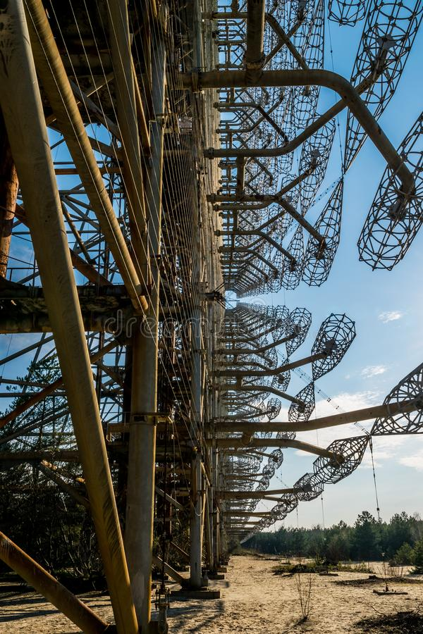 Echo of the Cold War. Secret Soviet over the horizon antenna known as the `Russian woodpecker`. Chernobyl Nuclear Disaster Exclusi. Old grand Soviet construction royalty free stock photo