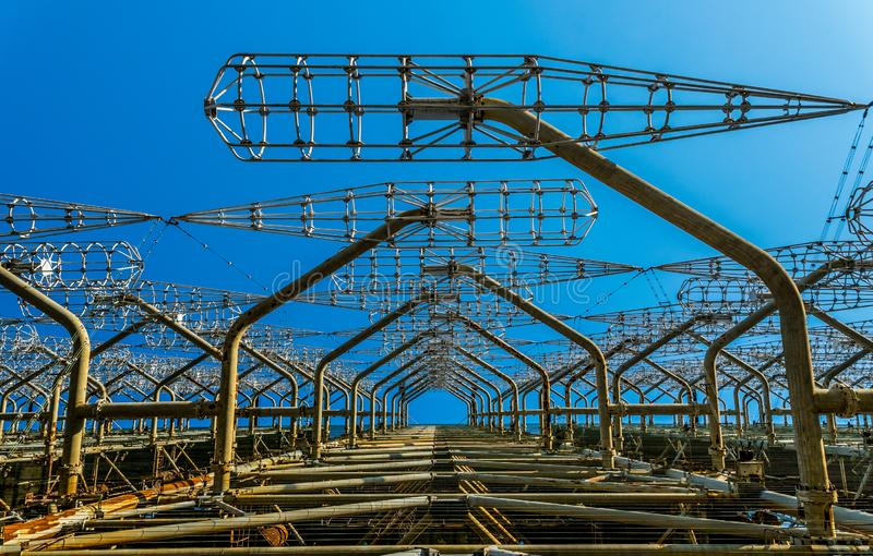 Echo of the Cold War. Secret Soviet over the horizon antenna known as the `Russian woodpecker`. Chernobyl Nuclear Disaster Exclusi. Old grand Soviet construction stock photos