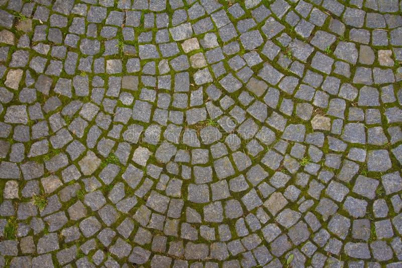 Old granite cobblestone sidewalk, horizontal shadowless abstract surface texture background stock photos