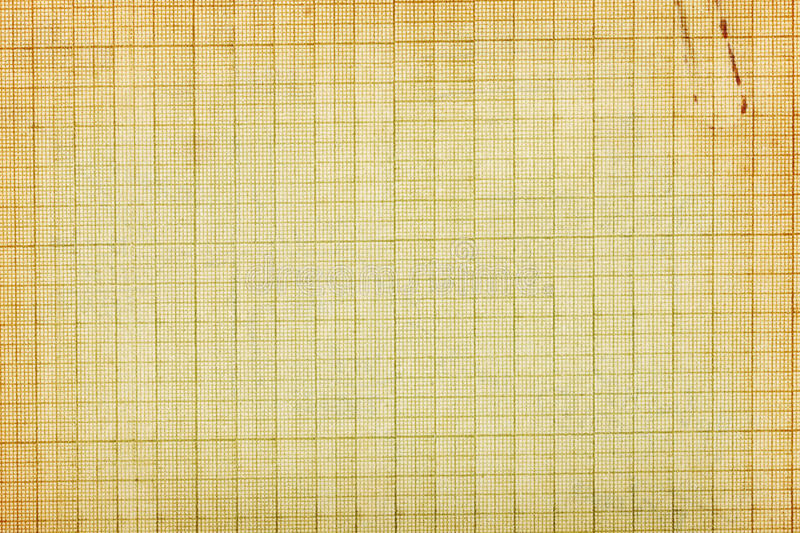 Old graph paper background. Old stained graph paper background with clip imprint stock photo