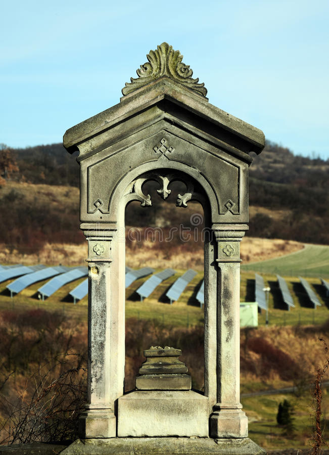 Old Gravestone and Solar Power Station royalty free stock photo