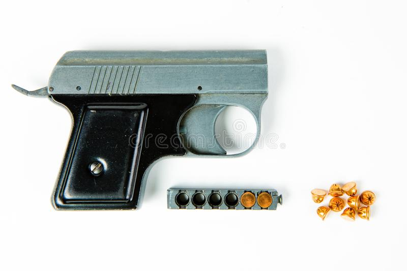 Old gray alloy starter pistol with black grip - magazine stock photography