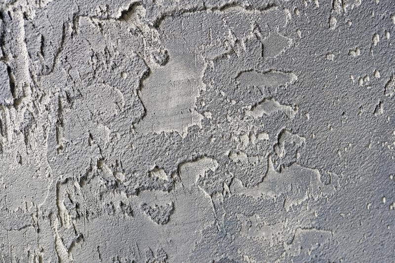 Old gray cement or concrete wall. Grunge plastered stucco textured background stock images