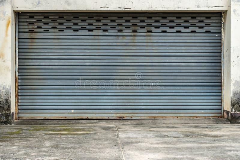 Old gray roller shutter door stock photo