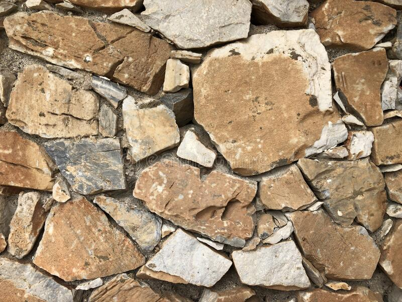 Old gray stone wall for abstract background royalty free stock photos