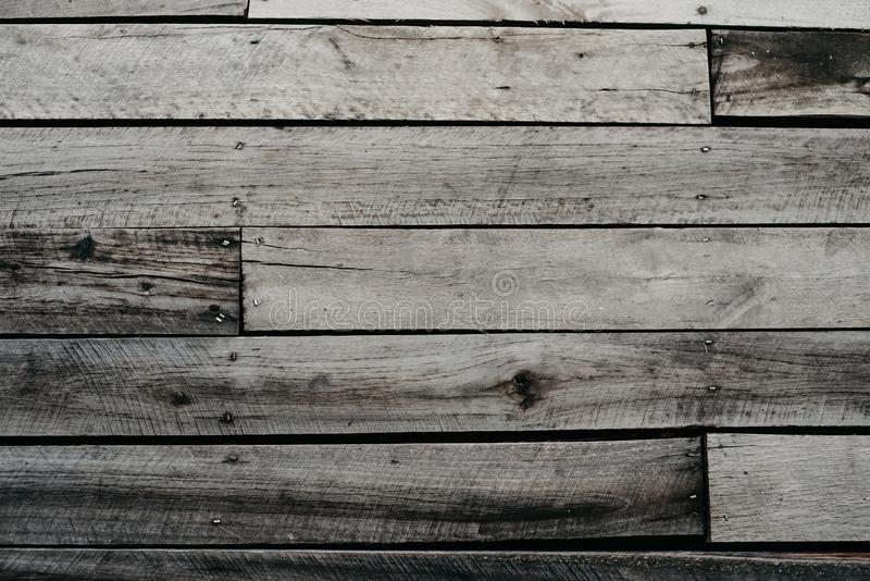 Backgound Old gray wood floor. Hard backgound Old gray wooden floor look vintage and grange stock photography