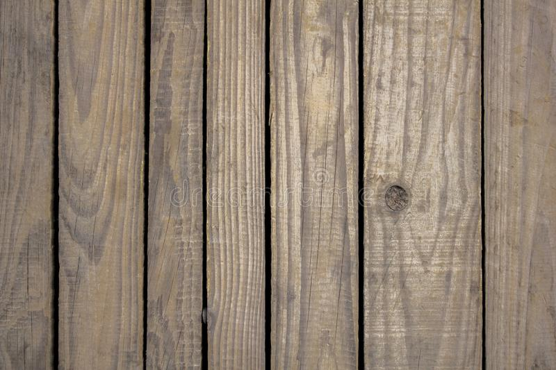 A old gray wooden boards with vertical slits and knots. natural surface texture stock photography