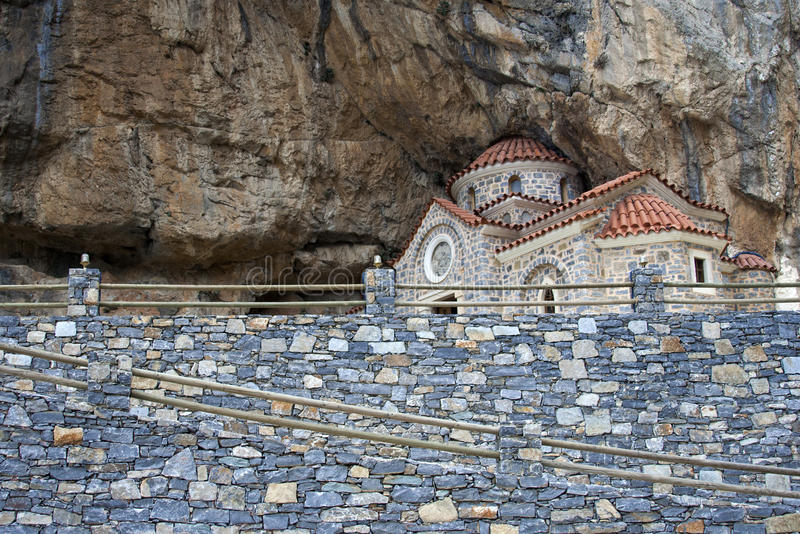 Old Greek church carved in mountain stock photos