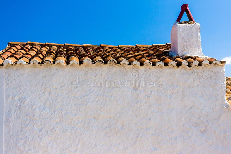 Old greek house with clean white facade wall, Greece. Old greek house with clean white facade wall and blue sky, Greece royalty free stock photography