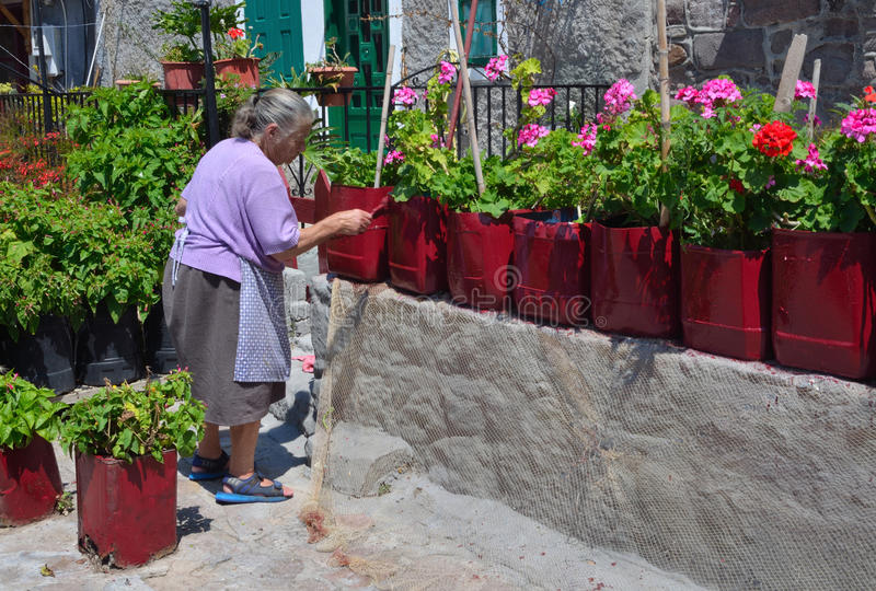 Old Greek Lady Painting Plant Pots stock image